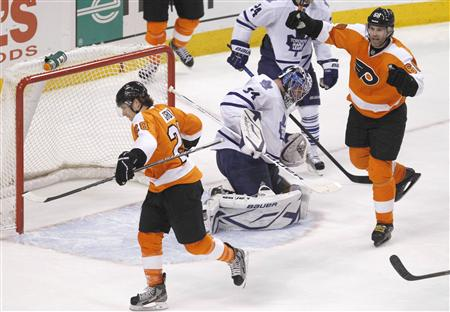 Flyers center Giroux and Flyers winger Jagr celebrate Girouxs goal against the Maple Leafs goalie Reimer during their NHL ice hockey game in Philadelphia