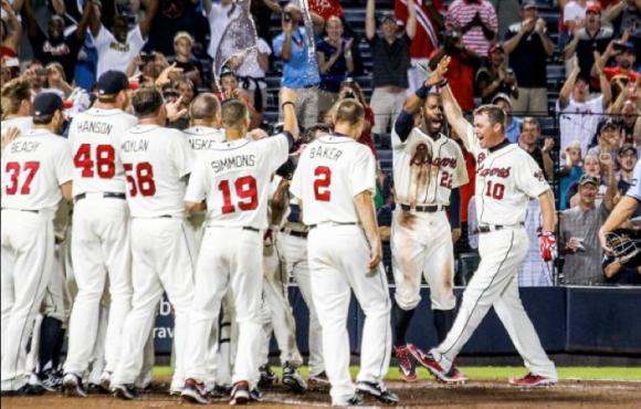 Jones celebrates with his teammates (via Getty Images).